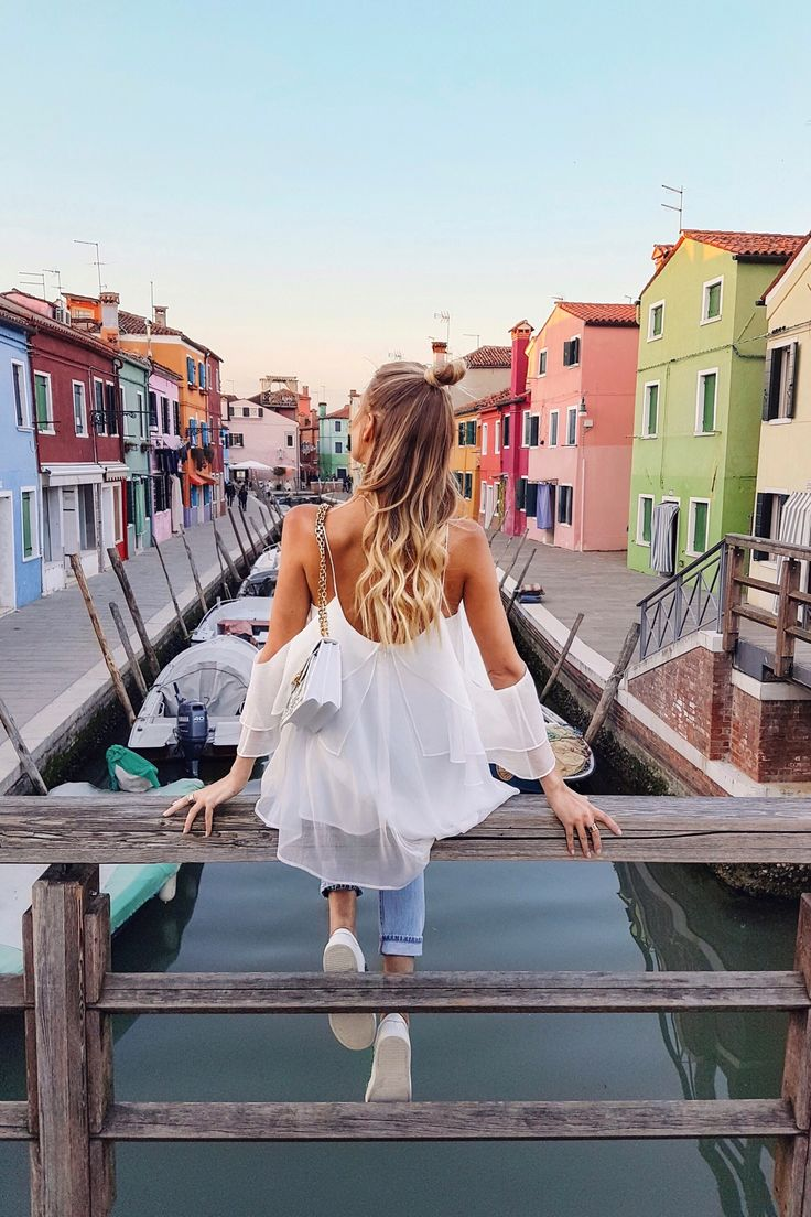 Colorful houses by the canal in Burano | Italy: www.ohhcouture.co… #leoniehann…