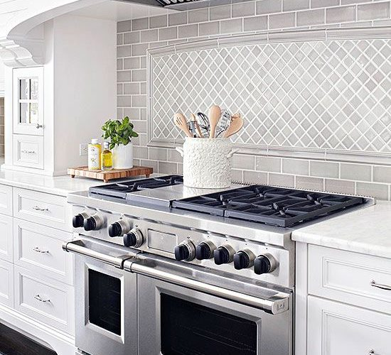 This kitchen is simple and symmetric with its neutral color palette and congruen…