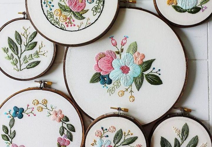 Hand embroidery, displayed in same-finish wooden hoops. Reminds me of a collecti…