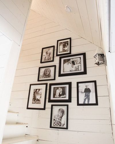 I like the photo display of family on a wall by stairs. Joanna Gaines's Blog…