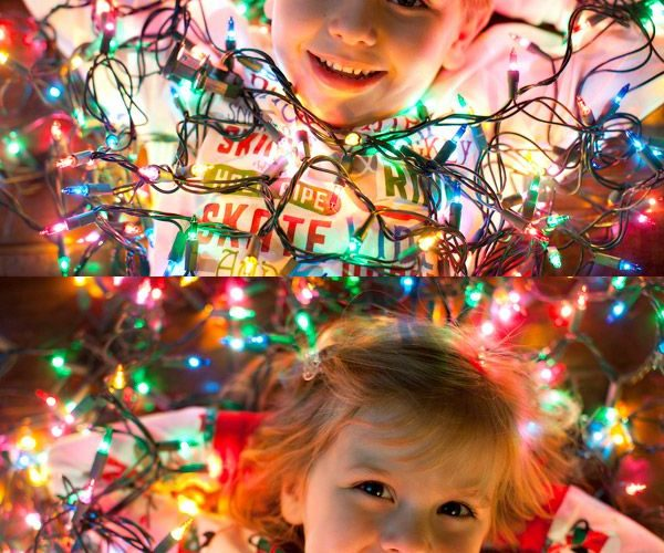 Strings of Christmas lights are the perfect photo prop to wish your loved ones a…