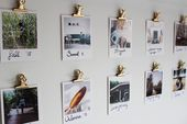 Spray paint bulldog clips and attach them to the wall with sticky tack to create…
